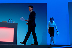 © London News Pictures. 25/09/2013 . Brighton, UK. Labour leader ED MILIBAND (left) and HARRIET HARMEN (right) arriving on stage ahead of a speech by Doreen Lawrence on the last day of thw  2013 Labour Party Conference at The Brighton Centre. Photo credit : Ben Cawthra/LNP