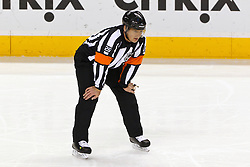 Jan 17, 2012; San Jose, CA, USA; NHL referee Rob Martell (26) before a face off between the San Jose Sharks and the Calgary Flames during the second period at HP Pavilion. San Jose defeated Calgary 2-1 in shootouts. Mandatory Credit: Jason O. Watson-US PRESSWIRE
