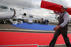September 7, 2017 - Moscow, Russia - Workers lay down red carpet near a Plane display at the annual JetExpo-2017 executive aviation exhibition held in Vnukovo International Airport.  (Credit Image: © Russian Look via ZUMA Wire)