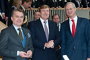 Koning Willem Alexander opent gerenoveerd BOVAGhuis in Bunnik. BOVAG is een brancheorganisatie van ruim 10.000 ondernemers die zich met mobiliteit bezighouden<br /> <br /> King Willem Alexander opens renovated Bovag House in Bunnik. Bovag is a trade association of more than 10,000 entrepreneurs engaged in mobility<br /> <br /> Op de foto / On the photo:  Koning Willem-Alexander verricht samen met directeur BOVAG J. Burgman (R) en BOVAG voorzitter L. Eckhardt de officiele opening van het gerenoveerde BOVAGhuisKoning <br /> <br /> King Willem-Alexander performed along with director J. BOVAG Burgman (R) and President L. Bovag Eckhardt, the official opening of the renovated House Bovag