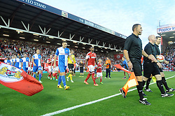 Teams walk out  - Photo mandatory by-line: Dougie Allward/JMP - Tel: Mobile: 07966 386802 04/09/2013 - SPORT - FOOTBALL -  Ashton Gate - Bristol - Bristol City V Bristol Rovers - Johnstone Paint Trophy - First Round - Bristol Derby