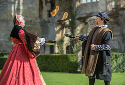 © Licensed to London News Pictures. 04/03/2019; Winchcombe, Gloucestershire, UK. Pancake tossing at Sudeley Castle. Queen Katherine Parr was among eight historic reenactors from Past-Times Living History who visited the Castle to celebrate its reopening after being closed for winter and also marked the historic tradition of Pancake Day, which has its origins in Tudor times. The tradition of making pancakes is long, and featured in cookery books as far back as 1439. The tradition of tossing or flipping them is almost as old. The castle and gardens are now open for the season. Sudeley Castle was one of the Tudors' most treasured palaces, often housing those closest to the crown. It's where Anne Boleyn stayed with Henry VIII while he decided to dissolve the monasteries, and where Katherine Parr, Henry's last wife, lived after he died. She now lies entombed in the Castle's church. Photo credit: Simon Chapman/LNP