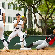 12 May 2018: San Diego State pinch runner Aris Metcalfe takes a hard slide into second base to break up a double play and keep the rally going in the bottom of the seventh inning. San Diego State women's softball closed out the season against Utah State with a 4-3 win on seniors day and sweep the series. <br /> More game action at sdsuaztecphotos.com