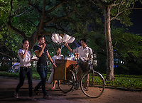 HANOI, VIETNAM - CIRCA SEPTEMBER 2014:  People walking at the Hoan Kiem Lake at night in Hanoi, Vietnam.