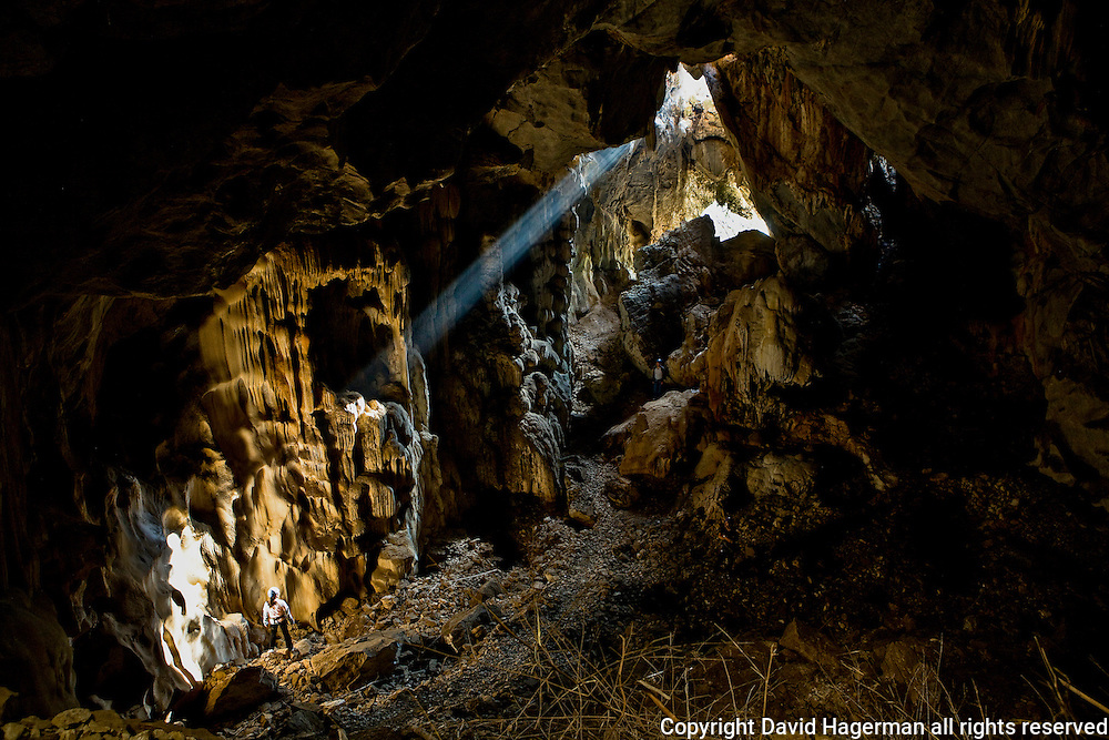 A lone climber in Chiang Mai's Crisis Anxiety Cave.