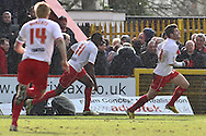 Picture by David Horn/Focus Images Ltd +44 7545 970036.16/03/2013.Dani Lopez of Stevenage (right).celebrates scoring his side's first goal  pursued by Lucas Akins and Mark Roberts, Captain of Stevenage during the npower League 1 match at the Lamex Stadium, Stevenage.