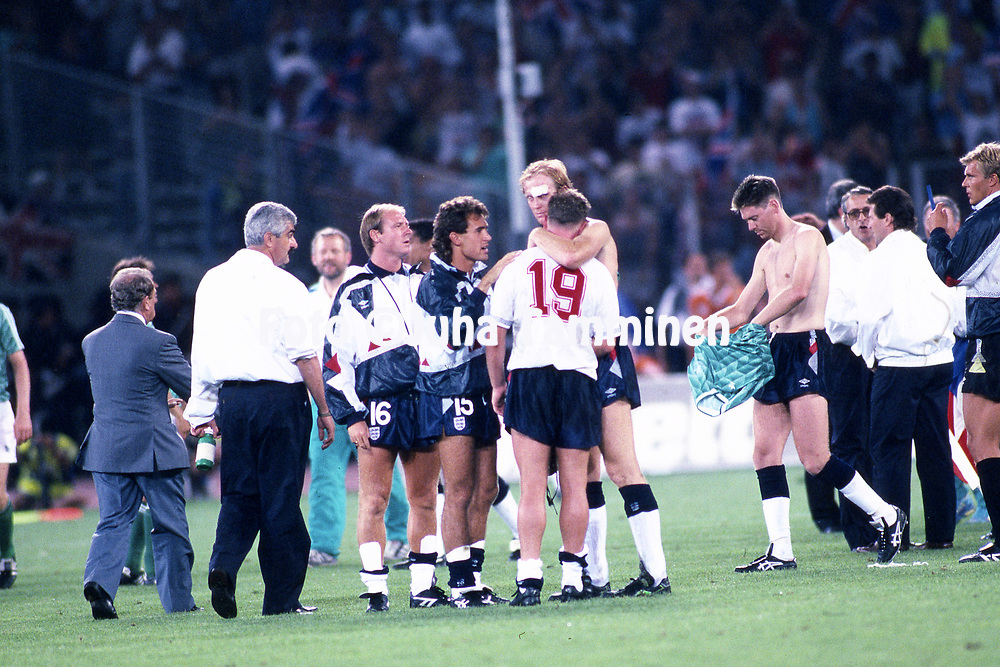 FIFA World Cup - Italia 1990<br /> 4.7.1990, Stadio Delle Alpi, Turin, Italy.<br /> Semi-final West Germany v England.<br /> England's Paul Gascoigne (19) in tears after the defeat. Cary Stevens, Tony Dorigo &amp; Mark Wright offer consolation. On right Chris Waddle with a German shirt.
