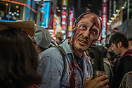 Foreign visitor to Japan dresses at the living dead at the Halloween celebration in Shibuya.  Tokyo, Japan.
