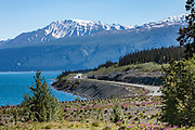 North America, Canada, Yukon Territory, Destruction Bay, Kluane National Park and Reserve.  View of Alaska Highway and Vulcan Mountain of the Kluane Mountain Range