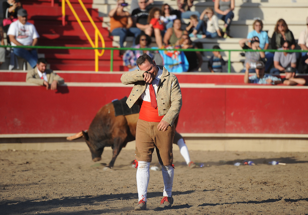 BEA AHBECK/NEWS-SENTINEL<br /> Grupo Forcados Amadores Luso-Americanos' David Magina wipes his face after his grab (their third) during the bloodless bullfight during the Our Lady of Fatima Portuguese Festival in Thornton Saturday, Oct. 14, 2017.