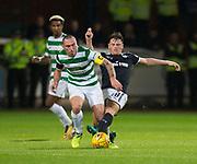 20th September 2017, Dens Park, Dundee, Scotland; Scottish League Cup Quarter-final, Dundee v Celtic; Dundee's Lewis Spence tackles Celtic's Scott Brown