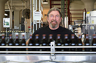 Keith Greggor, president and CEO of Anchor Brewers & Distillers in the bottling line at the Anchor Steam brewery in San Francisco, Calif.