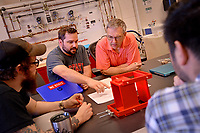 College of Engineering students and professor work on a project in the Havelock campus lab.