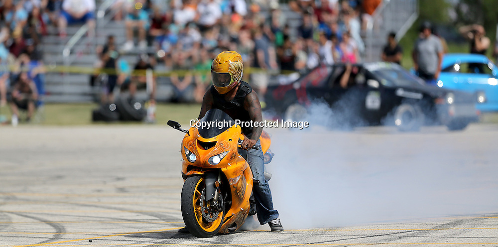 Wayne Nuytten does a burnout on his customized motorcycle during a drifting demo at Springs Church, Sunday, August 10, 2014. (TREVOR HAGAN/WINNIPEG FREE PRESS)