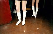 View of women's white gogo boots.