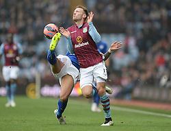 Leicester City's Danny Simpson tackles Aston Villa's Andreas Weimann - Photo mandatory by-line: Alex James/JMP - Mobile: 07966 386802 - 15/02/2015 - SPORT - Football - Birmingham - Villa Park - Aston Villa v Leicester City - FA Cup - Fifth Round