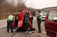 Ohio State Patrol troopers David Griffith (left) and Frank Simmons investigate an accident at the intersection of US 35 and Trebein Road near Xenia, Saturday, March 26, 2011.