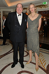 The HON.SIR NICHOLAS SOAMES & LADY SOAMES at the 24th Cartier Racing Awards held at The Dorchester, Park Lane, London on 11th November 2014.