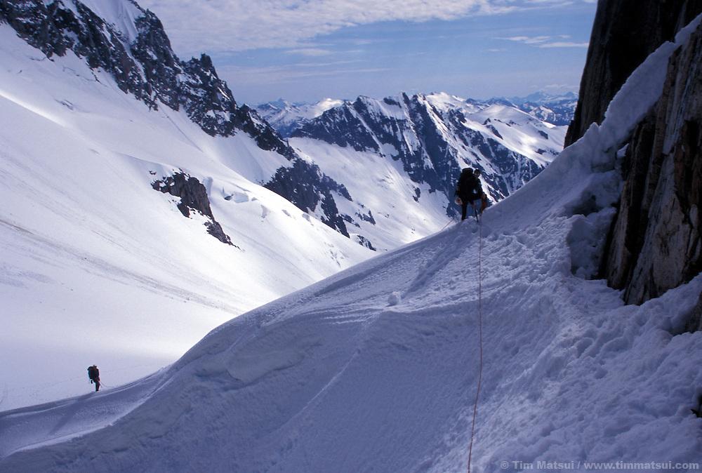 Climbers descend the snowy arete of El Dorado Peak in the North Cascades National Park.