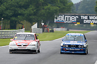 #98 John Cleland - Vauxhall Vectra passing #21 Max Goff - BMW M3 during HSCC Super Touring Car Championship qualifying at Oulton Park, Little Budworth, Cheshire, United Kingdom. June 07 2014. World Copyright Peter Taylor/PSP. Copy of publication required for printed pictures.  Every used picture is fee-liable. http://archive.petertaylor-photographic.co.uk