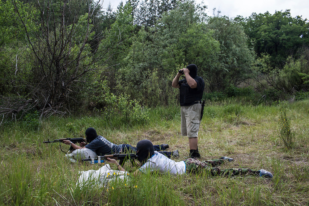 DNIPROPETROVSK REGION, UKRAINE - MAY 19: Recruits practice shooting guns at a firing range at a training camp for the Donbass Battalion, a pro-Ukrainian militia, on May 19, 2014 in Dnipropetrovsk Region, Ukraine. A week before presidential elections are scheduled, questions remain whether the eastern regions of Donetsk and Luhansk are stable enough to administer the vote. (Photo by Brendan Hoffman/Getty Images) *** Local Caption ***