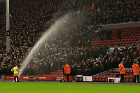 Football - 2012 / 2013 Premier League - Liverpool vs. Newcastle United<br /> A sprinkler turns on the crowd during half time at Anfield