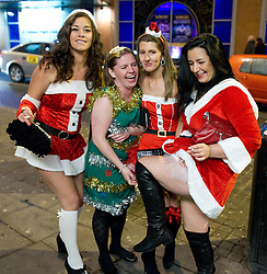 """© licensed to London News Pictures. Manchester, UK 17/12/2011. Despite freezing temperatures, """"Mad Friday"""" revellers in Manchester enjoy what is traditionally the busiest night of the year for emergency services, before Christmas. Photo credit: Joel Goodman/LNP"""
