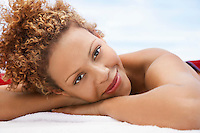 Woman lying on massage table head and shoulders