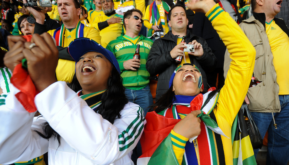 Fans react during the first game of the 2010 FIFA World Cup which had host nation South Africa playing Mexico to a 1-1 draw Friday, June 11, 2010 at Soccer City in Johannesburg, South Africa. Photo by Bahram Mark Sobhani