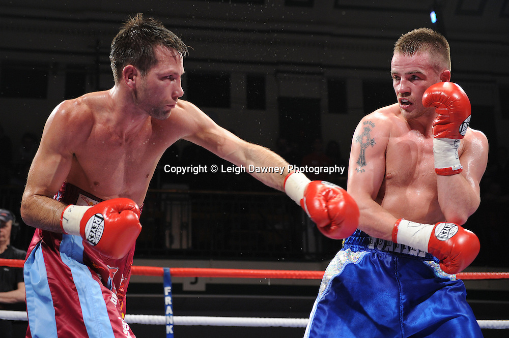 Light Welterweight Frankie Gavin (blue shorts) defeat Michael Lomax at York Hall, Bethnal Green, London on the 19th February 2011. Frank Warren Promotions. Photo credit © Leigh Dawney.