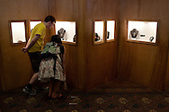 Visitors examine a jewelry exhibit.