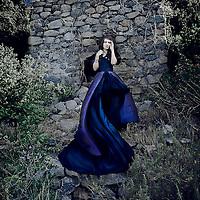 A girl wearing a flowing blue dress.