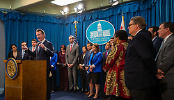 April 29, 2019 - Sacramento, CA, USA - California Gov. Gavin Newsom, left, flanked by lawmakers from both houses of the legislature, discusses the weekend shooting at the Poway Chabad Synagogue north of San Diego during a news conference Monday, April 29, 2019, in Sacramento, Calif. Newsom said he would increase spending to pay for increasing security at nonprofit organizations at higher risk because of their ideology, beliefs or mission. (Credit Image: © Paul Kitagaki Jr./ZUMA Wire)