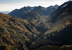 Porcupine Peak (upper right) looks down on McKinley Creek. Just below the farm of this image, Mckinley Creek flows into Porcupine Creek, a placer gold mining stream. The area pictured is part of land from the Alaska Mental Health Trust being leased by Constantine Metal Resources Ltd. for mineral rights only. Constantine Metal Resources Ltd. of Vancouver, British Columbia along with investment partner Dowa Metals & Mining Co., Ltd. of Japan is exploring a nearby potential site for a mine known as the Palmer Deposit.