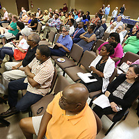 Lee County residents gather at the Link Centre Monday night for a Town Hall style event to listen to candidates for the upcoming Lee County primary races.