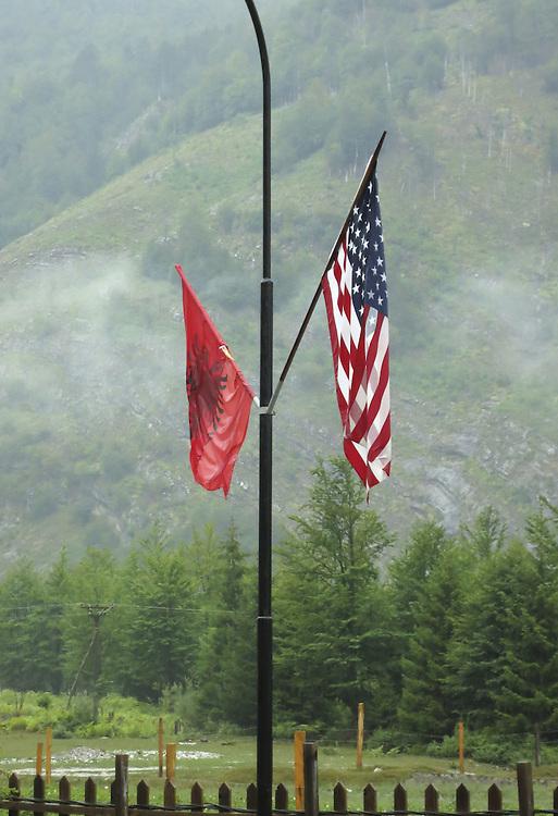Albania and USA flags, Valbona valley, Albania.