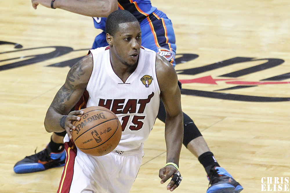 19 June 2012: Miami Heat point guard Mario Chalmers (15) goes to the basket during the Miami Heat 104-98 victory over the Oklahoma City Thunder, in Game 4 of the 2012 NBA Finals, at the AmericanAirlinesArena, Miami, Florida, USA.