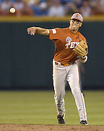 Texas shortstop Seth Johnston fires the ball to first for the final out of the game against Baylor.  Texas defeated Baylor in the first round of the College World Series 5-1 at Rosenblatt Stadium in Omaha, Nebraska on June 18, 2005.