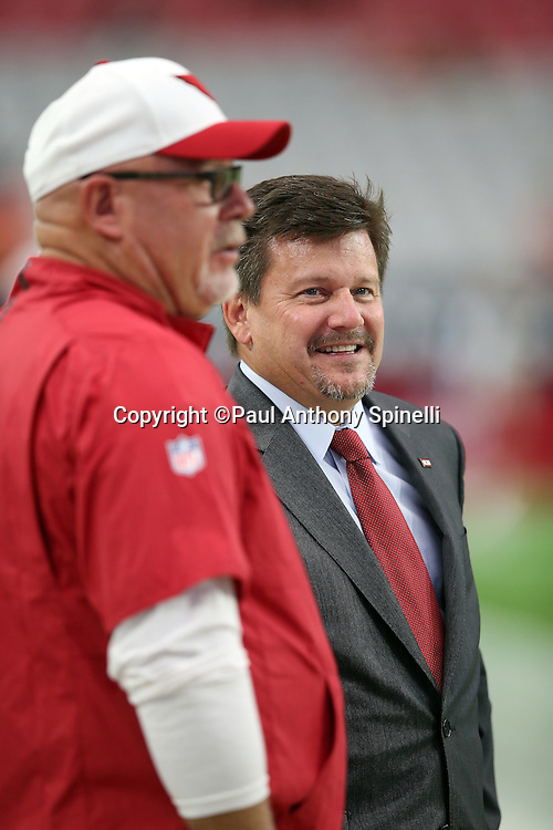 Arizona Cardinals president Michael Bidwill has a laugh while Arizona Cardinals head coach Bruce Arians looks on from the sideline before the 2015 NFL preseason football game against the Kansas City Chiefs on Saturday, Aug. 15, 2015 in Glendale, Ariz. The Chiefs won the game 34-19. (©Paul Anthony Spinelli)