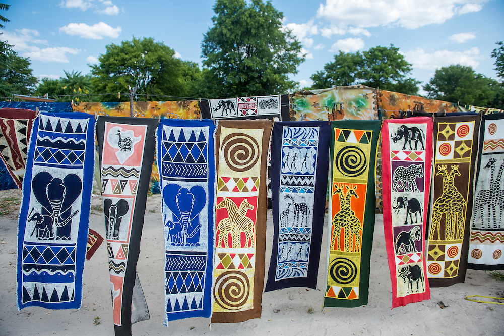 Maun, Botswana, Africa- Hanging decorative panels hand painted and for sale in the Sexaxa Village