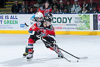 KELOWNA, CANADA - DECEMBER 6: Kris Schmidli #16 of the Kelowna Rockets is checked by Manraj Hayer #19 of the Everett Silvertips  on December 6, 2013 at Prospera Place in Kelowna, British Columbia, Canada.   (Photo by Marissa Baecker/Shoot the Breeze)  ***  Local Caption  ***