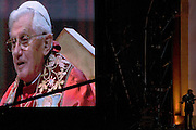 Pope Benedict XVI leads Mass at the Hyde Park rally during his papal tour of Britain 2010, the first visit by a pontiff since 1982. Taxpayers footed the £10m bill for non-religious elements, which largely angered a nation still reeling from the financial crisis. Pope Benedict XVI is the head of the biggest Christian denomination in the world, some one billion Roman Catholics, or one in six people. In Britain there are about five million Catholics but only a quarter of Catholics regularly attend Sunday Mass and some churches have closed owing to spending cuts.