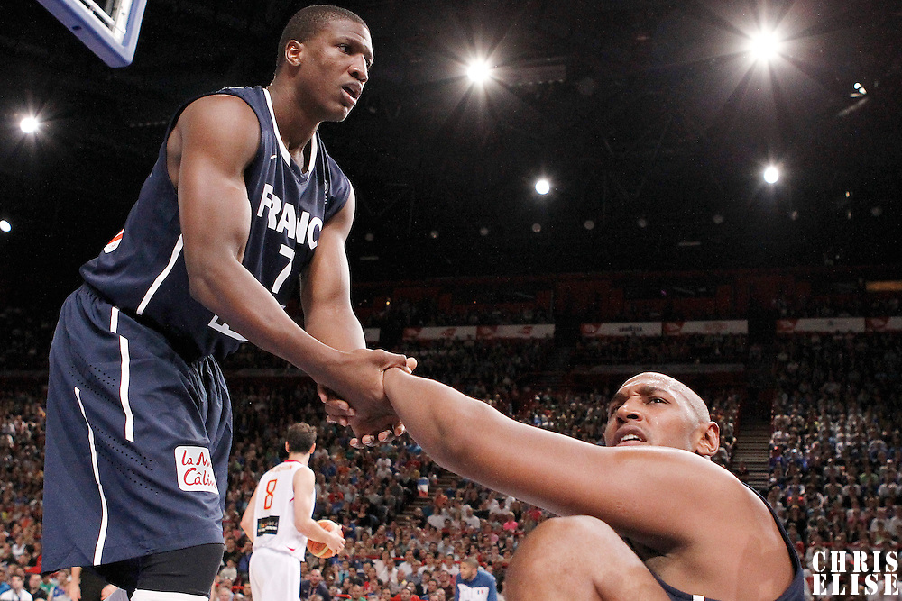 15 July 2012: Yakhouba Diawara of Team France helps Boris Diaw to stand up during a pre-Olympic exhibition game won 75-70 by Spain over France, at the Palais Omnisports de Paris Bercy, in Paris, France.