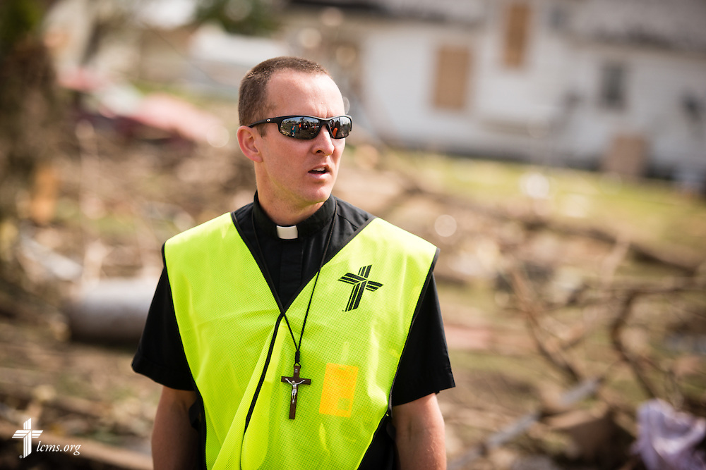 The Rev. Brian Bucklew, pastor at Zion Lutheran Church, surveys the damage to the surrounding neighborhood on Tuesday, May 12, 2015, in Delmont, S.D. A tornado swept through the area on Sunday and destroyed the church where Bucklew is pastor along with nearby buildings. LCMS Communications/Erik M. Lunsford