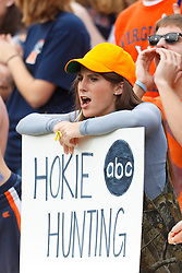 Nov 26, 2011; Charlottesville VA, USA;  A Virginia Cavaliers fan holds up a sign critical of the Virginia Tech Hokies before the game at Scott Stadium.  Virginia Tech defeated Virginia 38-0. Mandatory Credit: Jason O. Watson-US PRESSWIRE