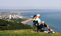 © Licensed to London News Pictures. 18/08/2012.A couple enjoying the view of Eastbourne from Beachy Head this evening (18.08.2012)..This weekend is set to be the hottest of the year as temperatures are predicted at 31C (88F) as.glorious sunshine hit the South East..Photo credit : Grant Falvey/LNP