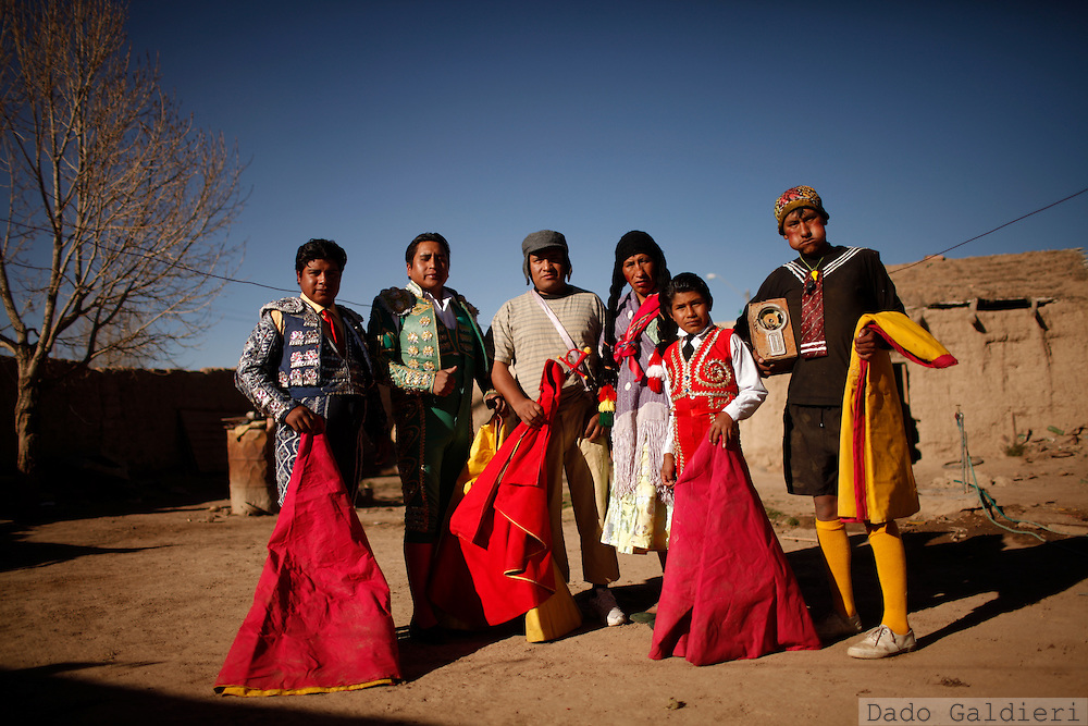 Performers pose for a portrait before presenting a bullfight parody in the Andean village of Vinto, Bolivia, Saturday July 10, 2010. A group of traveling amateur bullfighters presented a parody of the Spanish bullfight, but without the traditional sacrificing of the bull, as part of their tour through Bolivia's highlands providing entertainment during the southern hemisphere winter.