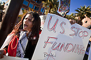 31 JANUARY 2011 - TEMPE, AZ:  NOOR SAIED, an Iraqi, demonstrates in Tempe, AZ, Monday in support of democracy in Egypt. About 200 people marched through central Tempe, AZ, near the Arizona State University campus Monday afternoon. The rally was organized by the Arab American Association of Arizona in solidarity with the ongoing pro-democracy rallies and demonstrations in Egypt and other Arab countries.    Photo by Jack Kurtz