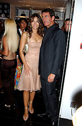 LIZ HURLEY and TIM JEFFERIES at a party hosted by Versace during London Fashion Week 2005 at their store in Slaone Street, London on 19th September 2005.<br />