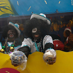 February 21, 2012; New Orleans, LA, USA; A rider holds out two Zulu coconuts during the Krewe of Zulu parade as it rolled along the uptown New Orleans St. Charles Avenue parade route throwing beads, painted coconuts and various trinkets on Mardi Gras day. Mardi Gras is an annual celebration that ends at midnight with the start of the Catholic Lenten season which begins with Ash Wednesday and ends with Easter. Photo by: Derick E. Hingle